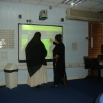 Using the interactive whiteboard, ESOL intermediate class.